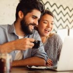 Married couple enjoying engaging with online meeting